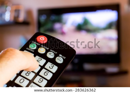 use the remote control to change channels on Television #283626362