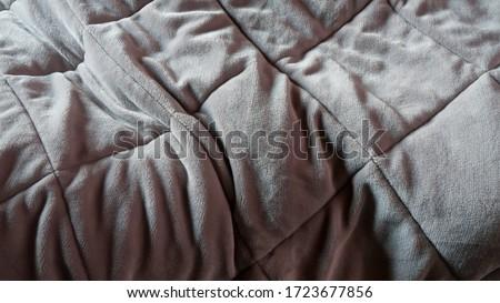 Use trace on grey blanket  Stockfoto ©