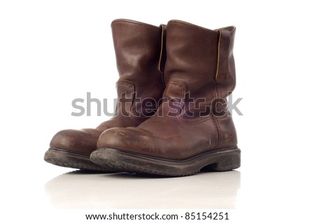 Used afety boots in brown color isolated white background
