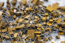 used and used electrical capacitors, top view. Background of capacitors