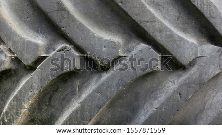 Used and worn car tires. Closeup the old dirty tire tread.