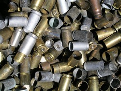 Used brass and steel ammo casings