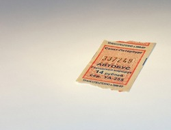 Used bus ticket with texts:
