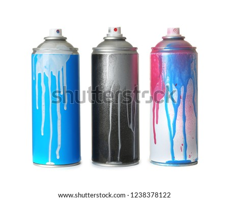 Used cans of spray paint on white background #1238378122
