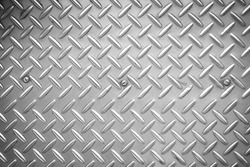 Used checkered steel plates background - Black and White