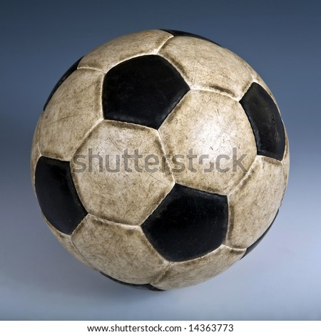 Used classic soccer ball. Color background - stock photo