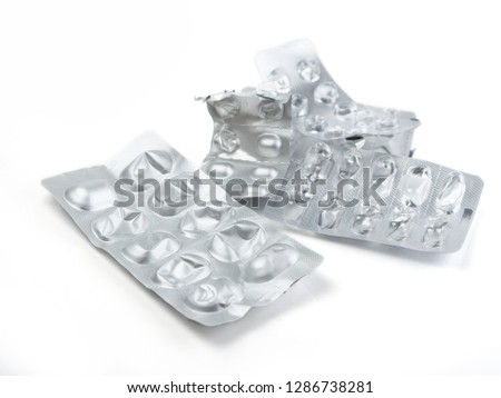 Used drugs, Used capsules, Used antibiotic packaging on white background, Close-up of empty pill package