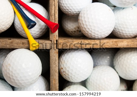 used golf balls and colored...