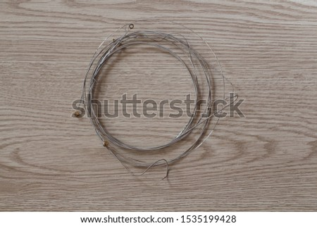 Used guitar strings winded up after change
