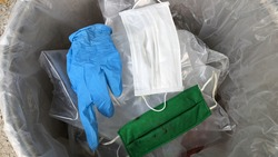 Used infectious masks and medical glove in the trash bin,infectious waste, prevented virus covid-19 by separating infected waste.
