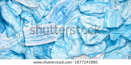 Used mask background. Disposal Coronavirus. Trash mask. Covid-19 waste. Rubbish. Discarded. Medical waste. Disposal. Waste. Litter mask. Contaminated. Garbage out. Covid-19 background. Masks in bin. Foto stock ©