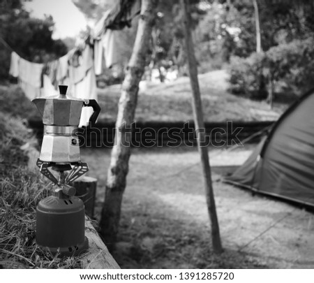 used moka used to prepare breakfast coffee in a camping  with black and white effect