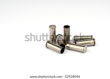 Used nickel plated .38 special shell casings - stock photo
