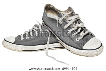 Used old sneakers isolated on white