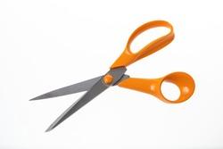 Used orange scissors on a white background