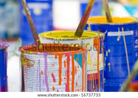 used paint buckets and brushes