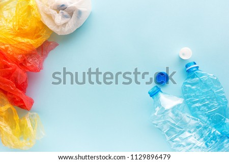 Used plastic bottles and bags for recycling, conceptual image with copy space
