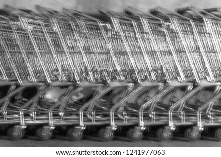 used shopping carts or used shopping trolley in black and white and blur effect