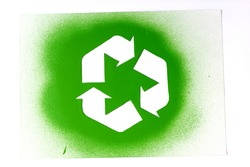 Used Stencil of Recycling Sign Sprayed With Green Paint