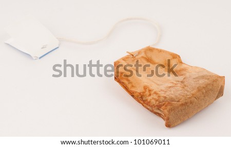 Used Tea Bag that's either Reusable or Trash on White Background