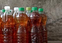 Used vegetable oil in bottle.