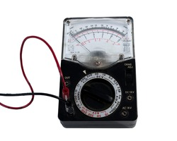 Used volt and ohm meter on a white background