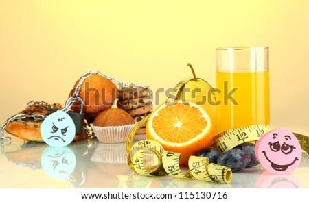 Useful and harmful food on yellow background