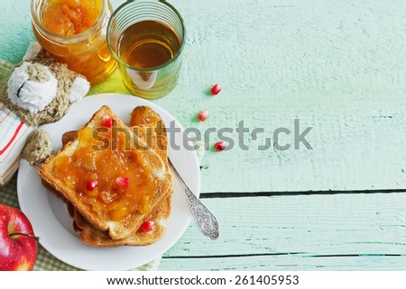 useful for children breakfast of toast with jam and fruit on green wooden table. children food concept. copy space background.top view