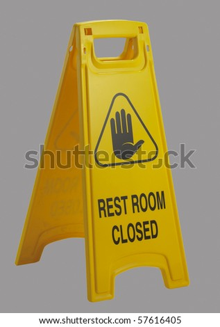 "Useful plastic stand-up sign reading ""rest room closed""."