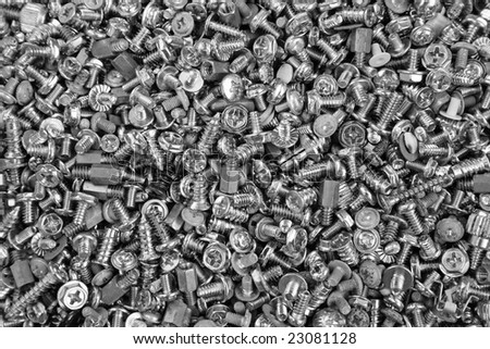 Useful screws and bolts in the storage . Black and white photo