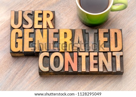 user generated content  - word abstract in vintage letterpress wood type blocks #1128295049