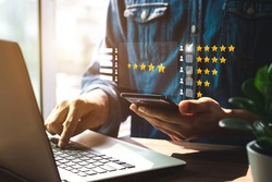 User give rating to service experience on online application, Customer review satisfaction feedback survey concept, Customer can evaluate quality of service leading to reputation ranking of business.