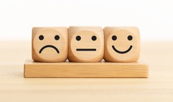 User service feedback, rating and customer review, experience, satisfaction survey concept. Wooden blocks with facial expressions