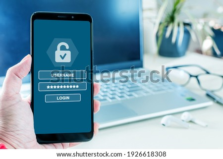 Username and password to login on cell phone screen, cyber security concept. Data protection and secured internet access, cyber security on smart phone.