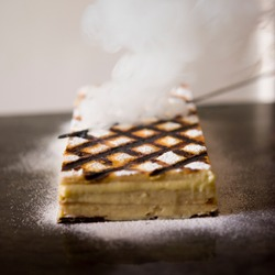 Using a hot skewer to burn a crosshatch pattern on Napoleons