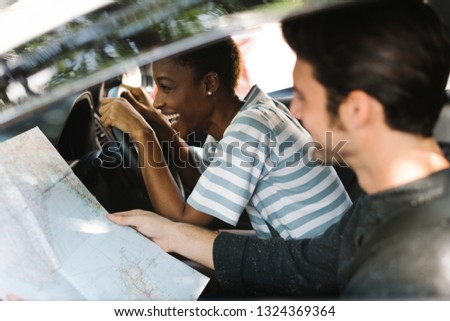 Using a map in a car for a direction #1324369364