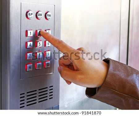 Using a Security Keypad - stock photo