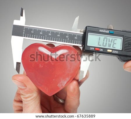 Using calipers to exactly measure a crystal heart