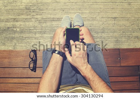 Using cellphone outdoors.