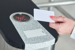 using electronic card key for access through turnstile