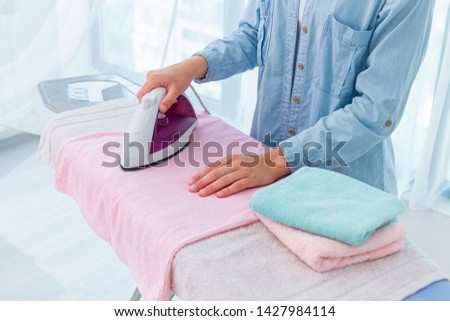 Using iron for ironing of linen and clothes after washing