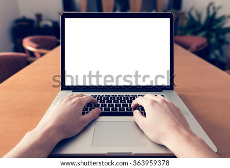 Shutterstock Using laptop with blank screen - POV - Point of view perspective