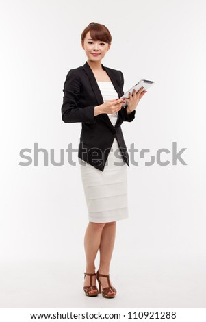 Using pad PC business woman isolated on white background.