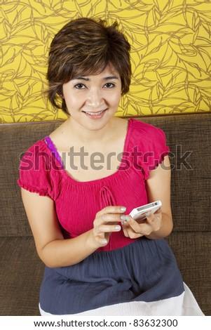 using smartphone. trendy female sliding finger on her smartphone.