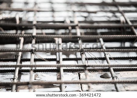 Using steel wire for securing steel bars with wire rod for reinforcement of concrete slab or focus to steel wire.