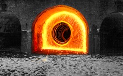 Using Steel wool a fire portal was created under a bridge in Nottingham