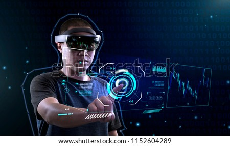Using VR glass to enter virtual reality world   Future Technology Magic Equipment   Men controls interfaces in augmented reality world #1152604289