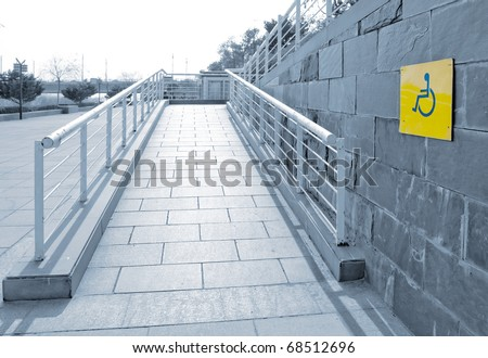 using wheelchair ramp(Barrier-free access) - stock photo
