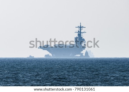 USS George H.W. Bush (CVN-77) usa navy nuclear aircraft carrier resupplying anchored in the Mediterranean sea while visiting Haifa port, Israel for rest and recreation on 4th of July 2017