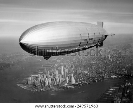 USS Macon, sister ship of USS Akron, over New York Harbor, ca. 1933. USS Macon, participated in Naval operations until crashing in a storm off Point Sur, California, on Feb. 12, 1935. - Shutterstock ID 249571960